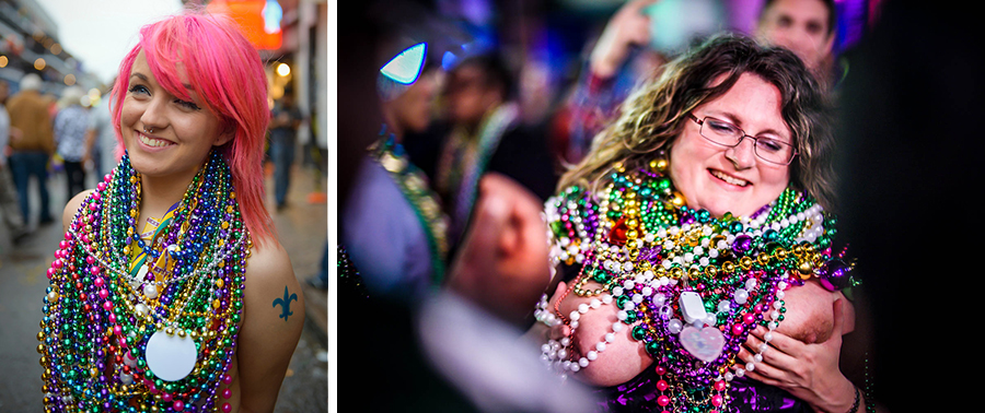 A young woman wearing lots of beads smiles on Bourbon Street during Mardi Gras in New Orleans, Louisiana