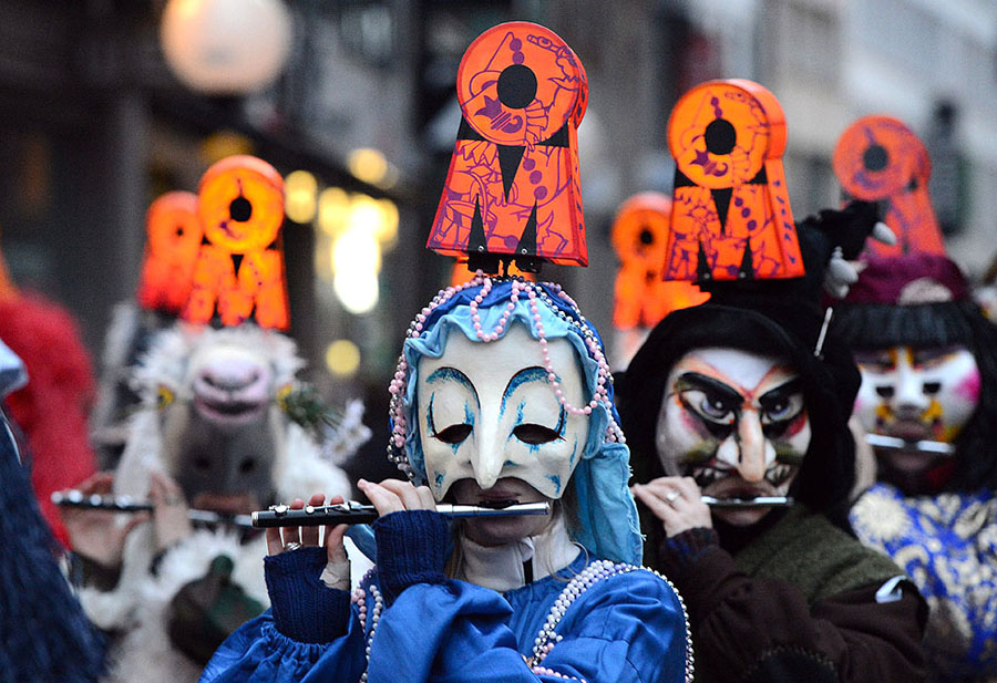 Carnival revelers move through the inner city making music at the 'Morgestraich' ('morning prank') celebrations in Basel. The 'Morgestraich' marks the beginning of the carnival of Basel lasting 72 hours which attracts thousands of spectators from Switzerland as well as from Germany, France and Luxembourg.